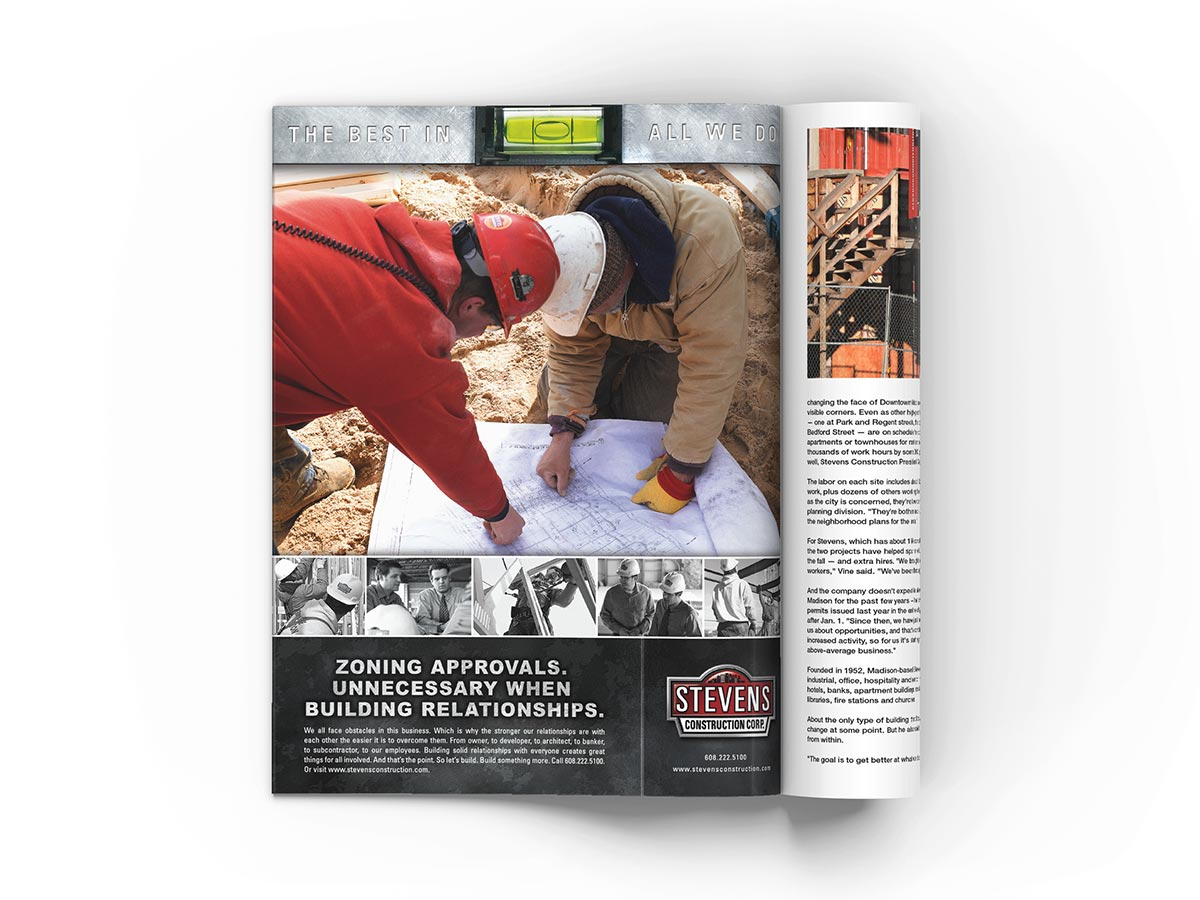 Full page magazine advertisement design featuring construction workers going over plans